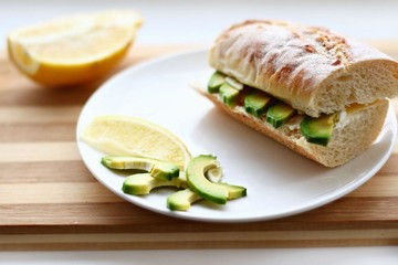 sandwich on a baguette with avocado, cheese and garlic