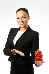 Business dressed woman with present.