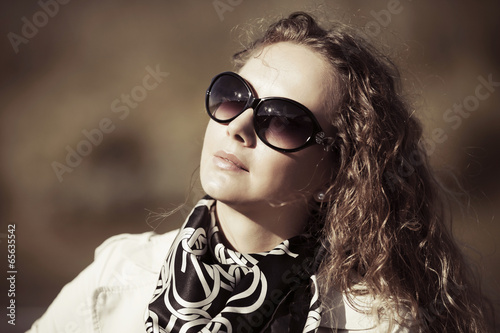 Fashion woman with long curly hairs
