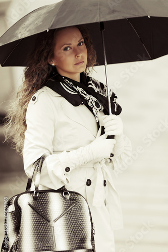 Fashion woman with umbrella in the rain