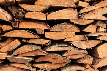 A pile of  stacked pieces of firewood