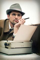 man typing on a typewriter
