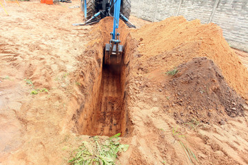 Pit, ditch or trench dug by special equipment - tractor