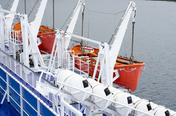 Safety lifeboats on deck of a ferry