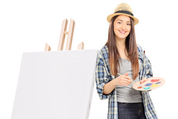 Female artist leaning on a canvas
