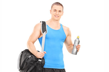 Male athlete holding a water bottle