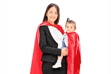 Mother and daughter in superhero costumes posing