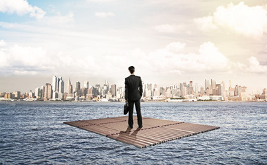 businessman standing on raft