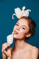 closeup of beautiful girl with white lily petal