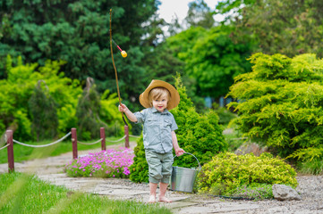 Happy country style kid with bucket and rod
