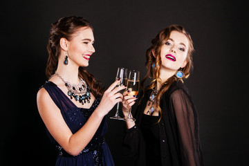 two young women with glasses of champagne