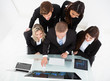 Businesspeople Using Desktop Pc At Desk