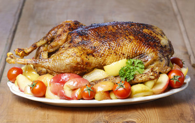 Roasted goose on wooden table