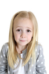cute blond girl with worried or undecided expression