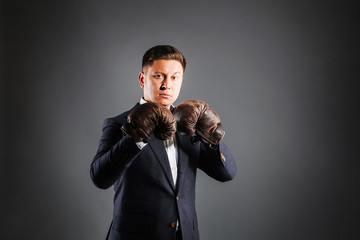 Portrait  attractive man wearing boxing-gloves
