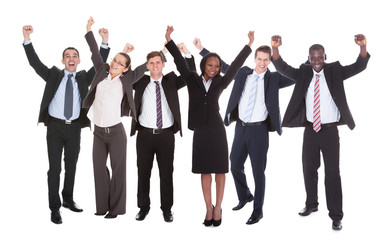 Successful Businesspeople With Arms Raised