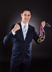 Smiling Businessman Wearing Medals