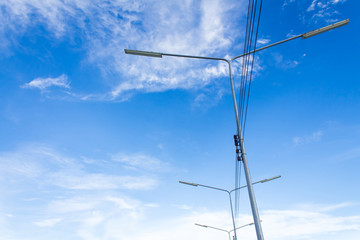 Electric lighting system tower on blue sky background