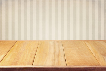 Background with retro srtiped wallpaper and empty wooden table