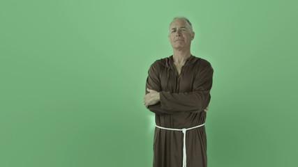 Senior caucasian monk isolated on chroma green screen confident