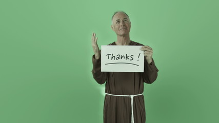 Senior caucasian monk isolated on chroma green screen grateful