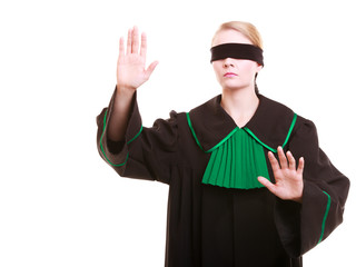 Lawyer in polish gown covering eyes with blindfold
