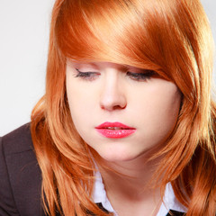 Portrait sad unhappy businesswoman. Closeup face redhaired girl.
