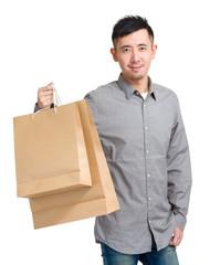 Handsome man holding shopping bag