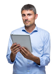 Caucasian man holding digital tablet