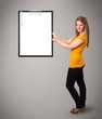 Young girl holding black folder with white sheet copy space
