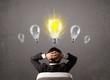 Business person having an idea light bulb concept