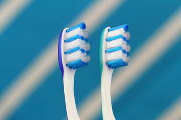Blue and green toothbrushes