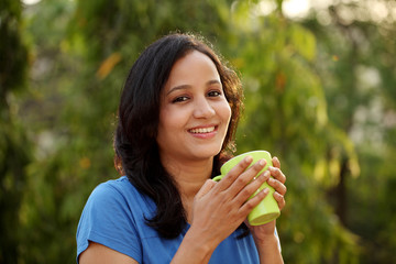 Young woman drinking coffee at outdoors