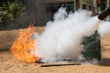 Demonstration of fire caused by gas canisters by fire extinguish