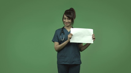 indian female doctor isolated on greenscreen happy with blank