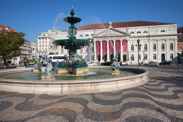 Fountain and Theater on Rossio Square in Lisbon