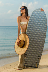 Asian model hodilng a surfboard