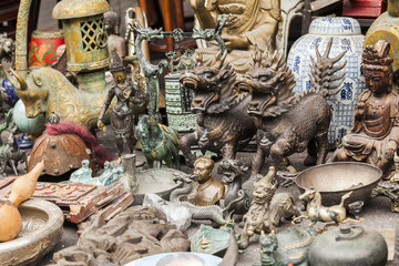 Souvenirs on Dongtai Lu antiques market in Shanghai, China.