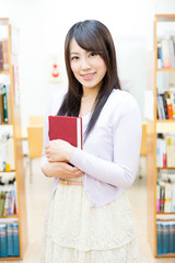 young asian woman in the library