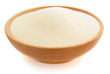 Leinwanddruck Bild - semolina in plate bowl on white