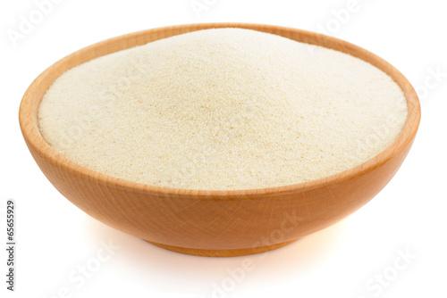 Leinwanddruck Bild semolina in plate bowl on white