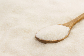 white sugar and spoon