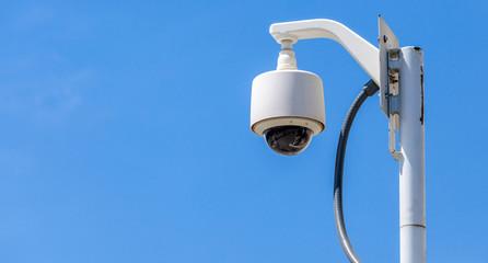 Security camera, CCTV on blue sky background