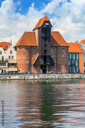 The medieval port crane over Motlawa river in Gdansk, Poland © Patryk Kosmider