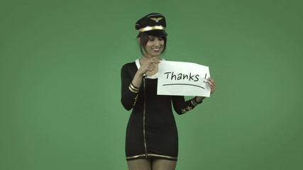 indian air hostess isolated on green with thanks sign