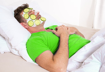 man in bed with facial