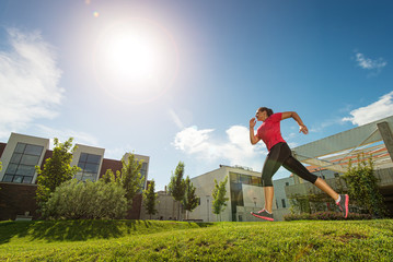 Running woman. outdoors, behind buildings