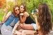 Three beautiful girlfriends make: sending kiss photo