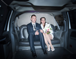 Newlyweds in the limousine