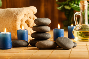 Spa still life with hot stones and candles